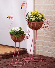 Set of 2 Bird Planters. Each metal bird contains a coconut fiber basket with glass bead detailing in the eye and on the tail. Flamingos or Peacocks.