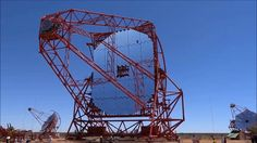 The huge Cherenkov Telescope CT5 of the H.E.S.S. telescopes array dancing with the smaller CT3 (left) and CT2 (right).