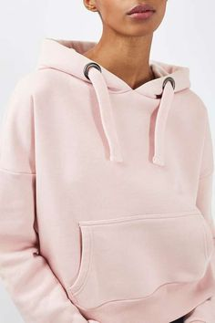 The hoodie goes luxe in this oversized style by Boutique. Crafted in a powder pink cotton blend, it comes with chunky cord detailing and a practical front pocket. In a cropped fit, style with high waisted denim for an elevated laid-back look. #Topshop
