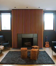 LOS ANGELES HOME WITH WOOD-CLAD INTERIOR Home owner Bill Thompson warmed up his otherwise dark living room with a series of Douglas fir s...
