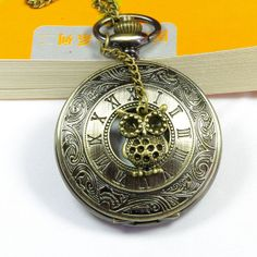 I lied this is the one I am buying  antique Steampunk owl Pocket Watch Locket Necklace. $6.99, via Etsy.