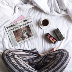 Solo breakfast in bed with a hot cup of tea and some delicious macarons. #Padgram