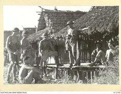 A Group of Australians near their billets, somewhere in New Guinea. Photo: 012709 | Australian War Memorial