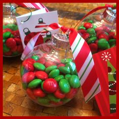 Treats for school friends. M&M's inside ornaments tied with ribbon.