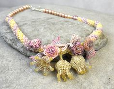 A bridal necklace for a floral bride https://www.etsy.com/au/listing/458077516/floral-bead-crochet-rope-pastel-floral