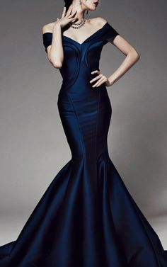 This duchess Zac Posen gown features a bustier-style boned bodice with a sweetheart neckline, pleated off-the-shoulder straps and a a dramatic pleated trumpet skirt.Hidden zip back closure89% polyester, 8% polyamide, 3% elastaneFully lined, crinolineMade in USAPlease note:This item may be returned for M'O credits.