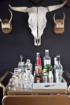 Pretty bar cart vignette. I still haven't figured a way to squeeze a cart into our space, though god knows we need one.