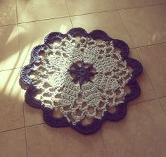 pattern for this Mandala Crochet Rug sold through Ravelry.