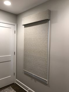 Blackout roller shade with valance. You can see that they made this shade outside mount to block as much light as possible BUT you do still have a small light gap