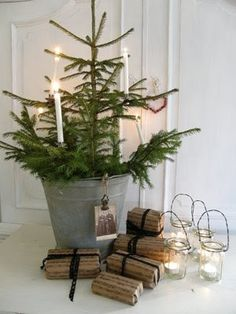 Christmas awesomeness from Norway -- A plain Christmas candle in a candle clip graces a sweet table-top tree. Traditional Christmas tree candle holders, candle clips and imported candles avaiable from www.christmasgiftsfromgermany.com