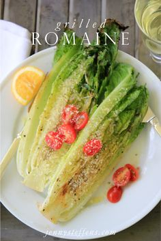 1/2 cup of olive oil 1 lemon, juice & zest  1 tablespoon of rosemary, minced 1 teaspoon of garlic, minced sea salt cracked pepper .... 2 small-ish heads of romaine (I used the pre-packaged hearts) 1 lemon, quartered 1/2 cup of parmesan cheese, fresh grated  cherry tomatoes