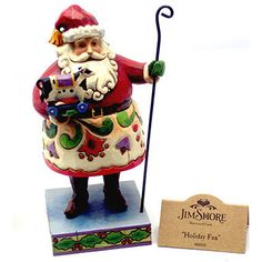 This Santa Claus figurine by Jim Shore features folk art patterns and is made to resemble carved wood.