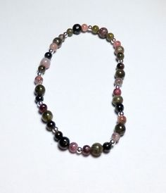 This bracelet is so pretty!    Tourmaline and Sterling Silver Beadwork Stretch Bracelet by tzteja