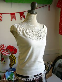 Custom made t-shirt. It's decorated with an old lace doily piece. (By Tiina Talvikki)