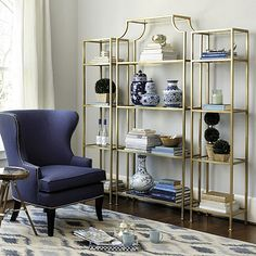 Use one alone or pair them flanking our Chloe Wide Etagere to create a wall of storage. Frame is crafted of steel and features four clear glass shelves.