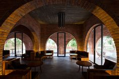 Wangstudio's F Coffee is a Vietnam cafe made up of 24 brick arches