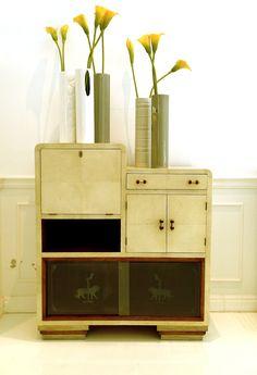 Original art decò bar-cabinet renovation by genuine white parchment.