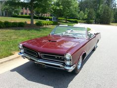 65 Pontiac GTO. My Dad's first car fresh out of the Marines,  working for GM. A burgundy 65 convertible,  white leather and top. Red line tire delete, with knock off hubcaps. 389 tri-power, track pack,  would have been worth some coin!