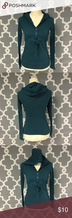 Aeropostale Hoodie 🔘Description: Aeropostale Hoodie size XS color is teal blue with snap buttons half way up and tie at waist. Good used condition  🔘Measurements:       Pit to Pit: 15 inches       Shoulder to Hem: 24 inches                              Inventory:    ⭐️ 15% Off All Bundles! 🛍    💞Thanks for stopping by! 😘 Aeropostale Tops Sweatshirts & Hoodies