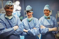 Portrait of surgeon and nurses standing with arms crossed in operation room #paid, , #affiliate, #Ad, #nurses, #surgeon, #operation, #standing Photography Backdrop Stand, Arms Crossed, Nurses, Backdrops, Portrait, Room, Fashion, Bedroom, Moda