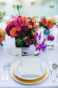 colorful place setting - photo by Imaj Gallery http://ruffledblog.com/vibrant-bali-wedding-with-a-hanging-botanical-installation