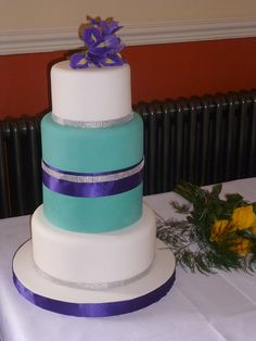 Wedding cake in purple and turquoise