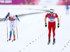 Johan Olsson (L) of Sweden and Dario Cologna of Switzerland compete in the Men's 15 km Classic during day 8