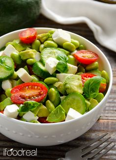Chopped Edamame Caprese Salad - I have this weirdly delicious & clean salad for you. Tomatoes, cucumbers, avocado, fresh mozzarella and edamame with basil vinaigrette.