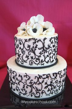Cake from a Scrollwork video tutorial on MyCakeSchool.com~ Buttercream with fondant/gum paste flowers.