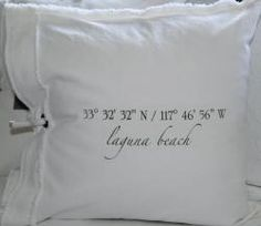 Latitude/Longitude embroidered pillows - c o t t a g e - a coastal store  (towels would be cute, too)