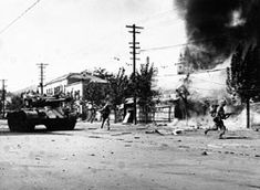 Marine infantry lead an M26 tank Much of Seoul was destroyed in vicious street battles in September, 1950. Here marine infantry lead an M26 tank in the attack. (U.S. Marine Corps photo.)