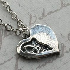 I love this necklace! If only I could afford it ..... it is $220. Sterling silver, but it is hand made