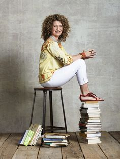 """Naidre Miller, 44, mother to Julian, 3  Nutrition counselor and cooking instructor """"I've found that slim-fit jeans, paired with a tunic, look best on me,"""" explains Naidre, who favors brightly colored cotton tunics from India and Mexico in eye-catching colors like yellow or blue. """"The combination accentuates my legs and hides my middle. Plus, bright colors make me happy, and they also complement my number-one accessory: my crazy-curly hair!""""   Embroidered top, Vintage Havana, $48. """"Lily""""…"""