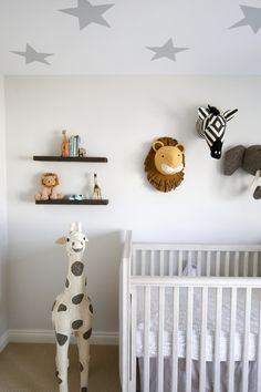 White And Grey Gender Neutral Safari Nursery With Green Chevron Beaded Chandelier Faux Animal