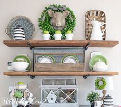 Open rustic industrial farmhouse shelves decorated for spring with black, white and green || Worthing Court