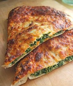 Recipe for Spinach Ricotta Calzone - A calzone is thin-crust pizza folded before you bake it — rather than after! If you love pizza (and who doesn't?), you will love these calzones!