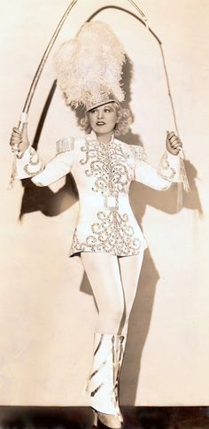 """MAE WEST as Tira the Lion Tamer in 'I'm No Angel' 1933. Costume by Travis Banton. Amazing how Mae is wearing these calf lenth cuffs that flare at the bottom to cover her double decker shoes. At only 5 feet tall, these hidden shoes added an extra 9"""" in height. Vintage original photo detail. (please follow minkshmink on pinterest) #maewest #liontamer #circus"""