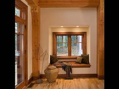 Timber Frame House Nook - wood trim around windows & doors