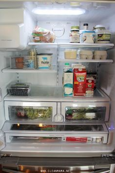Organize and clean your fridge logically and efficiently. Love those plastic bins!