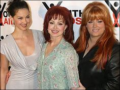 Singer Naomi Judd, center, poses with her daughters, actress Ashley Judd, left, and singer Wynonna Judd at the YouthAids Second Annual Gala on Monday, Oct. 27, 2003, in New York.