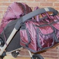 Voyage Diaper Bag: Metallic-Plum. Easily attaches to any stroller with easy access once attached.