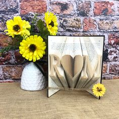 Folded books make great gifts. A couples first wedding anniversay in paper and their initials in a book like this will be treasured for years. #bookfolding #bookart #anniversarygiftsforhim