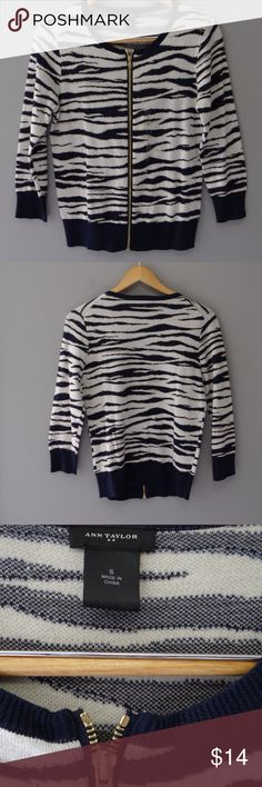 NWOT Ann Taylor knit NWOT small animal print white, grey, and navy blue knit with front gold zipper.  Ann Taylor factory. Three-quarter sleeves. Ann Taylor Sweaters Cardigans