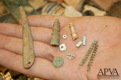 Jamestown; Artifacts recovered from the cellar/well feature: bone needle, ivory chess pieces, a 1613 English farthing, Virginia Indian shell beads, glass trade beads and copper baubles -- used to decorate hair and clothing.