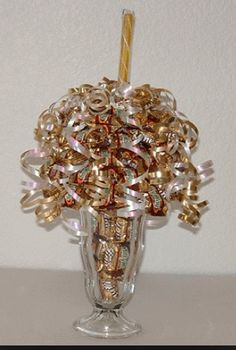 I LOVE this Candy bouquet idea! I'm going to try to do this one for my sons 2nd birthday party too cute!!!