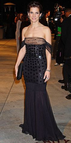 Sandra Bullock's Style Evolution | PAILLETTES PRINCESS | She opted for an off-the-shoulder gown covered in oversize sequins for the 2002 Vanity Fair Oscars party and a hairstyle that was probably spotted at proms across the country that year.
