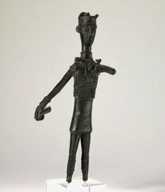 British Museum. Cultura nuragica Bronze votive figure of a warrior holding a sword, wearing a horned cap, cuirass, greaves and armour on neck, wrist and hands