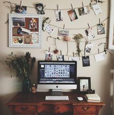 Beautiful work space decorated with photos.