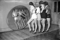 Students at a dance school dancing in front of a large, round mirror. (Photo by Hulton Archive/Getty Images). Circa 1935