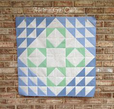 """Inspired by Lynne from Lilys Quilts block from Love Patchwork & Quilting issue 15, Amanda from Material Girl Quilts created a one block quilt using lovely Oakshott Fabrics as a sweet baby gift!  """"For the quilting I wanted to keep it simple and not too dense so that it will remain nice and snuggly for baby. I followed the lines in the block and quilted a large cross-hatch using #Aurifil 50 wt. 2600. I think it compliments the design nicely."""""""
